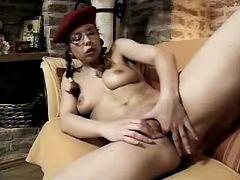 School lesbian masturbates on sofa
