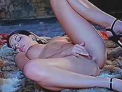 Horny lesbian masturbates on floor