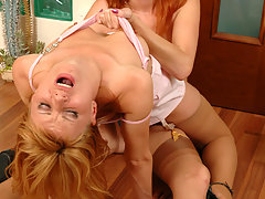 Voluptuous lesbian chick eagerly jumping on a strap-on right on the floor