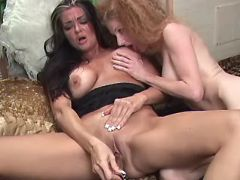 Redhead babe serves mature lesbian