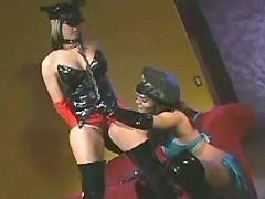 Lusty lesbian in latex spoils cutie